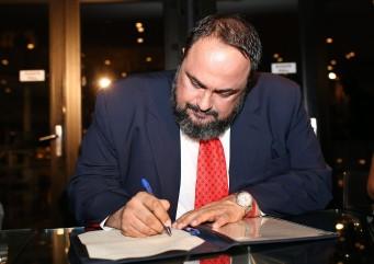 Evangelos Marinakis signs The Principle of Athens